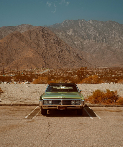 buick-car-parked-in-the-middle-of-the-desert