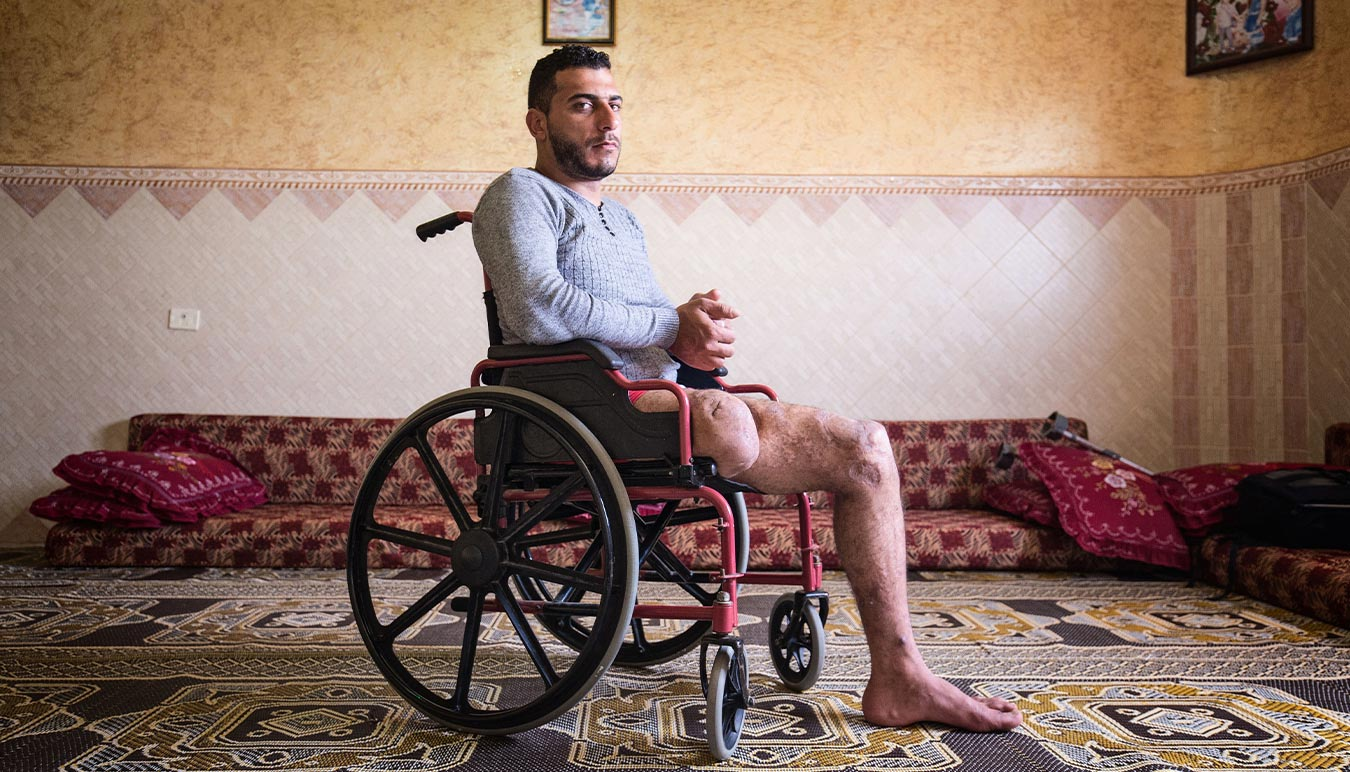 This image of an injured Syrian man in a wheelchair forms part of a collection in Australian photographer Darrian Traynors exhibition Occupation Displacement