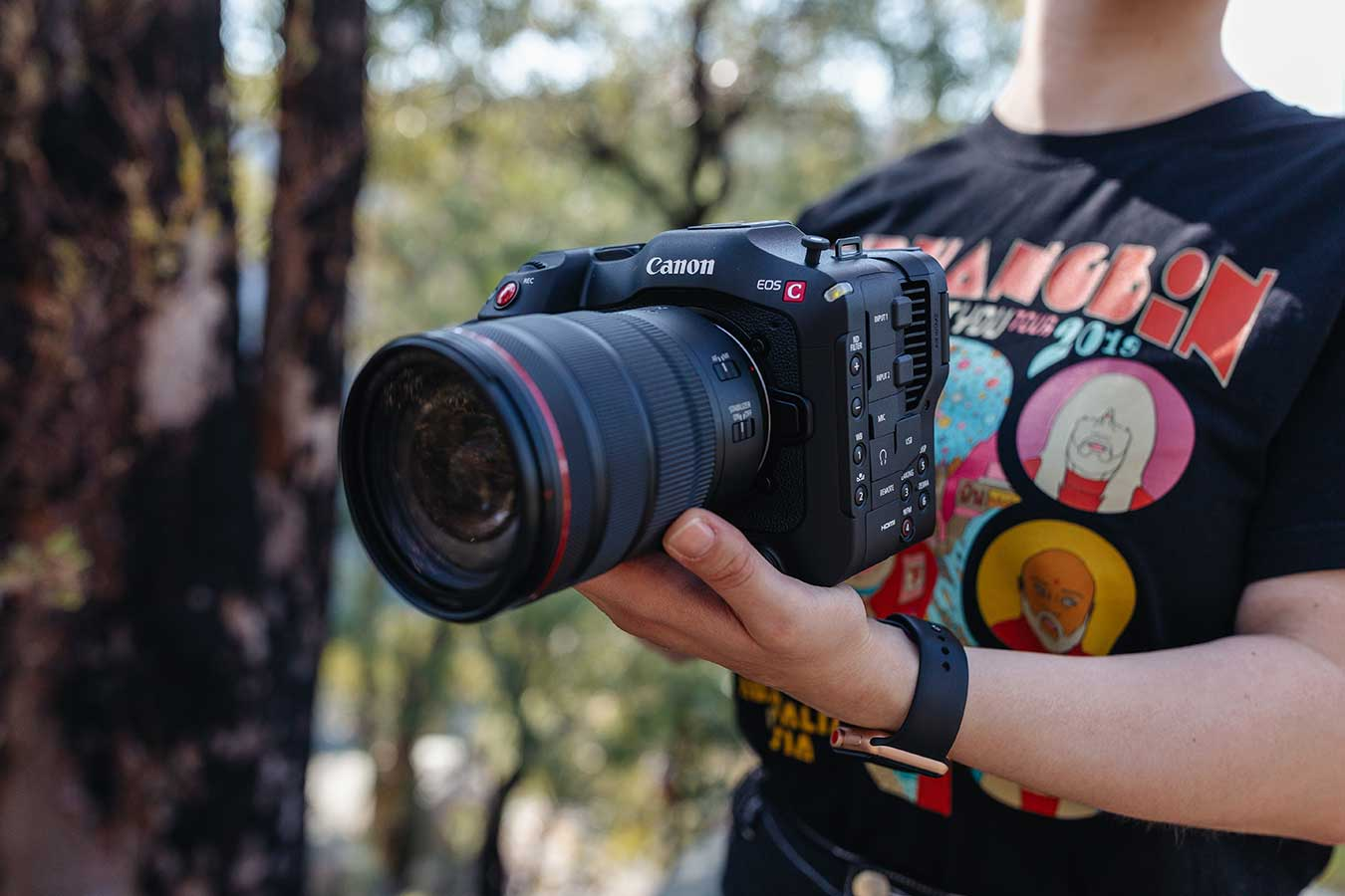 canon-eos-c70-handheld-by-woman-with-lens