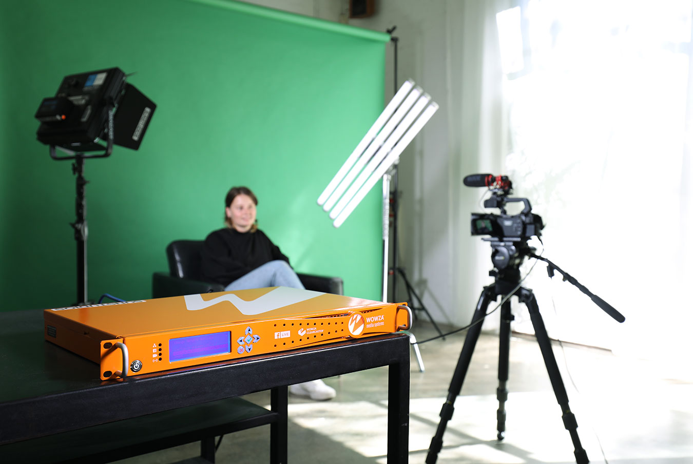 woman-being-filmed-in-front-of-a-green-screen-under-lights-clearcaster-pro-in-foreground