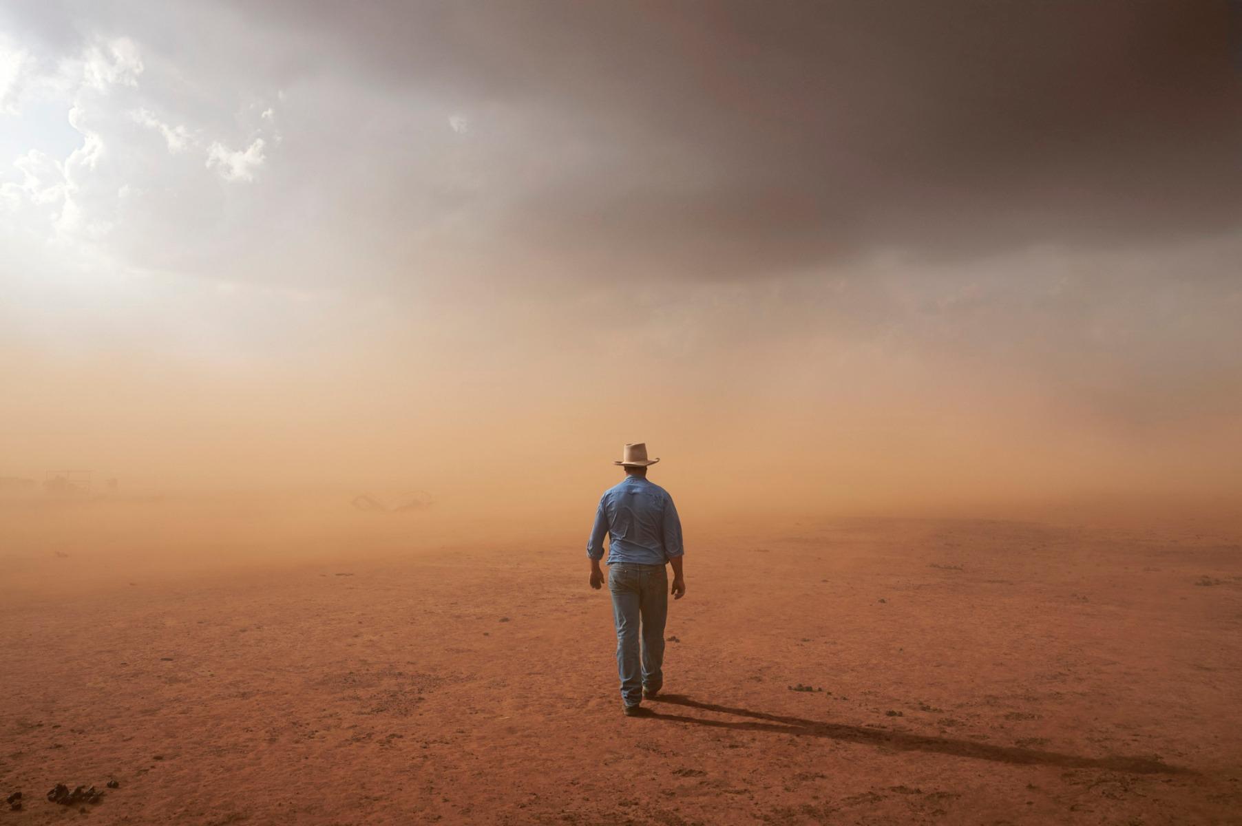 a-farmer-walks-into-a-dust-storm