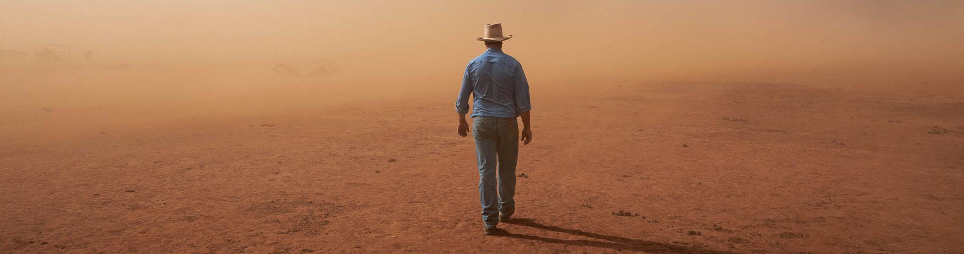 a-farmer-walks-into-a-dust-storm-lacking-a-horizon