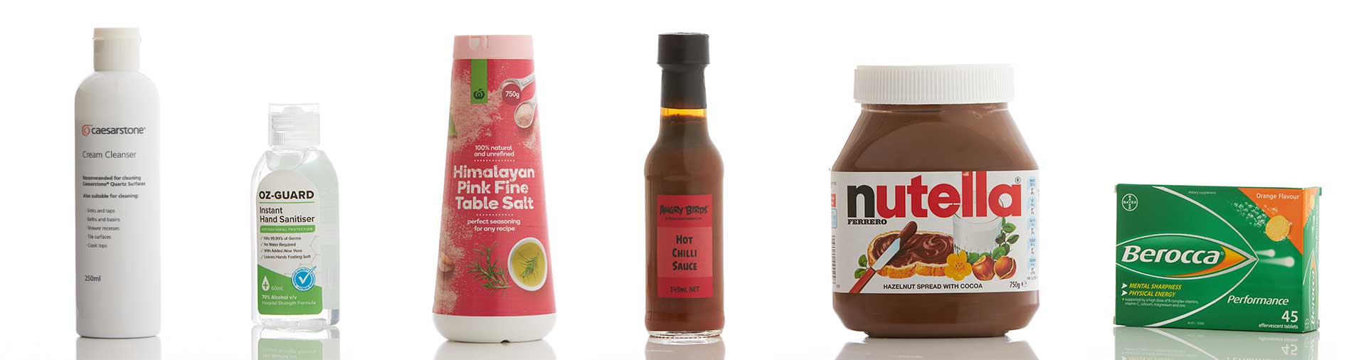 various-products-including-nutella-hand-sanitiser bottles-photographed-on-a-clean-white-background