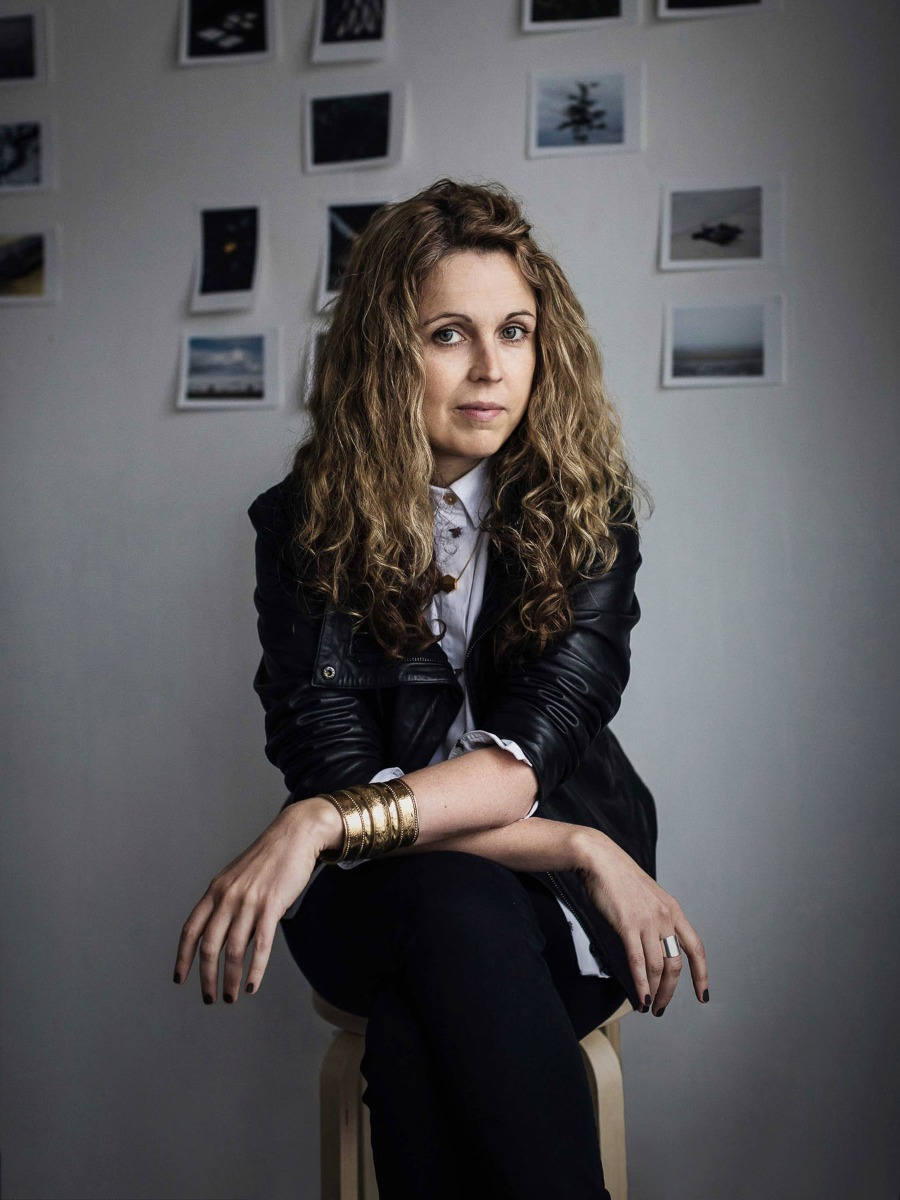 portrait-of-sinead-mcdevitt-with-backdrop-of-photographic-prints