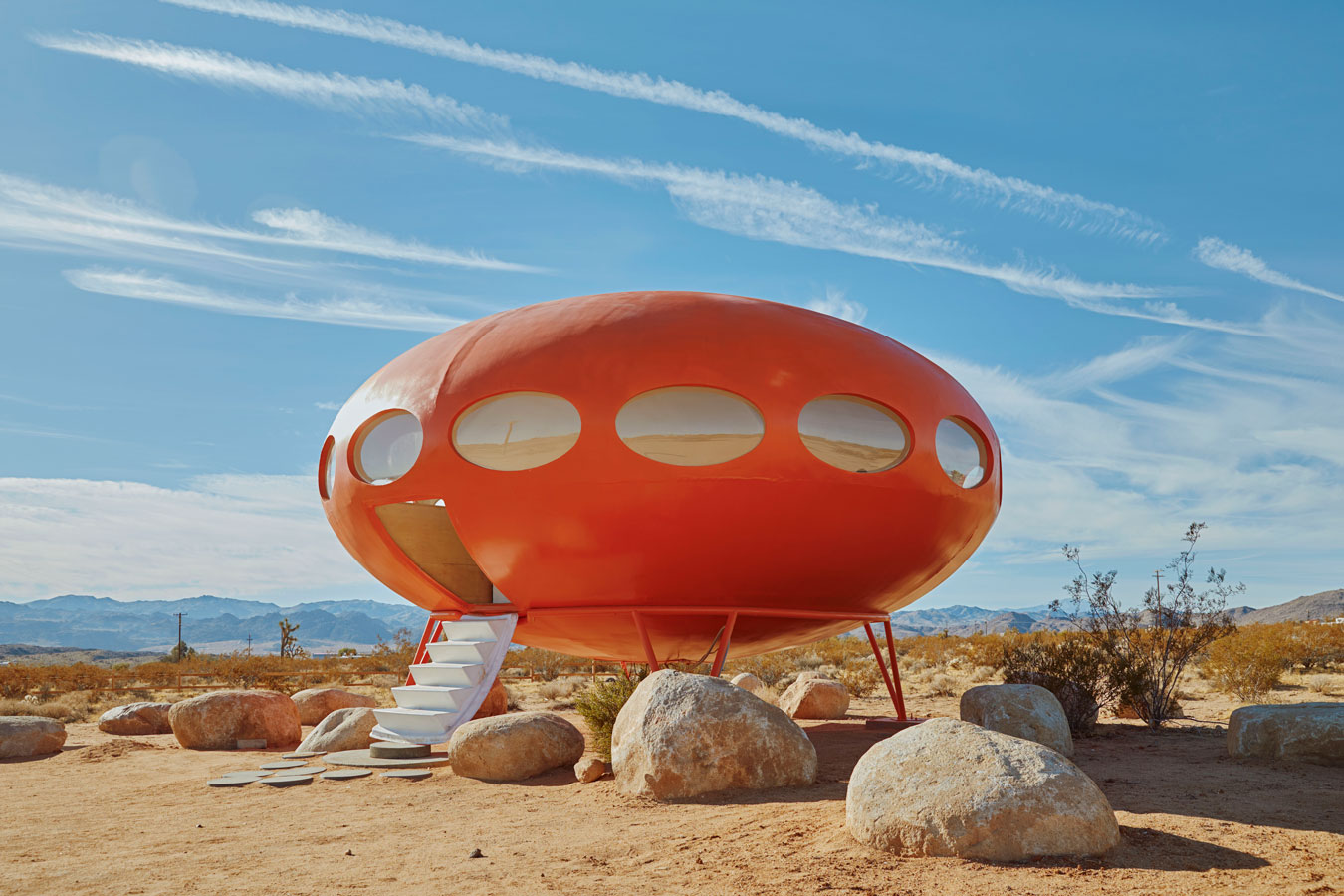 brightly-coloured-red-ufo-house-in-the-middle-of-a-desert