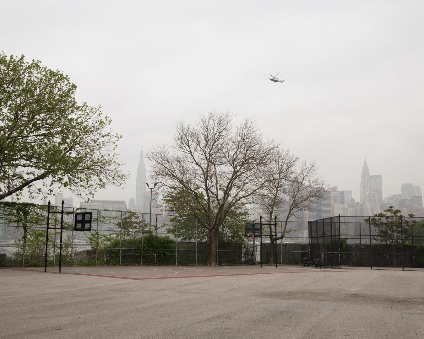 new-york-urban-basketball-coart-with-helicopter-overhead