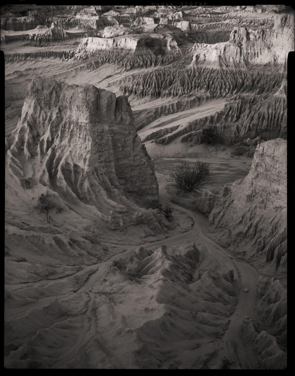 black-and-white-landscape-photogrpah-of-paakantji-country-mungo-lake-including-deep-crevices-that-appear-like-amoonscape