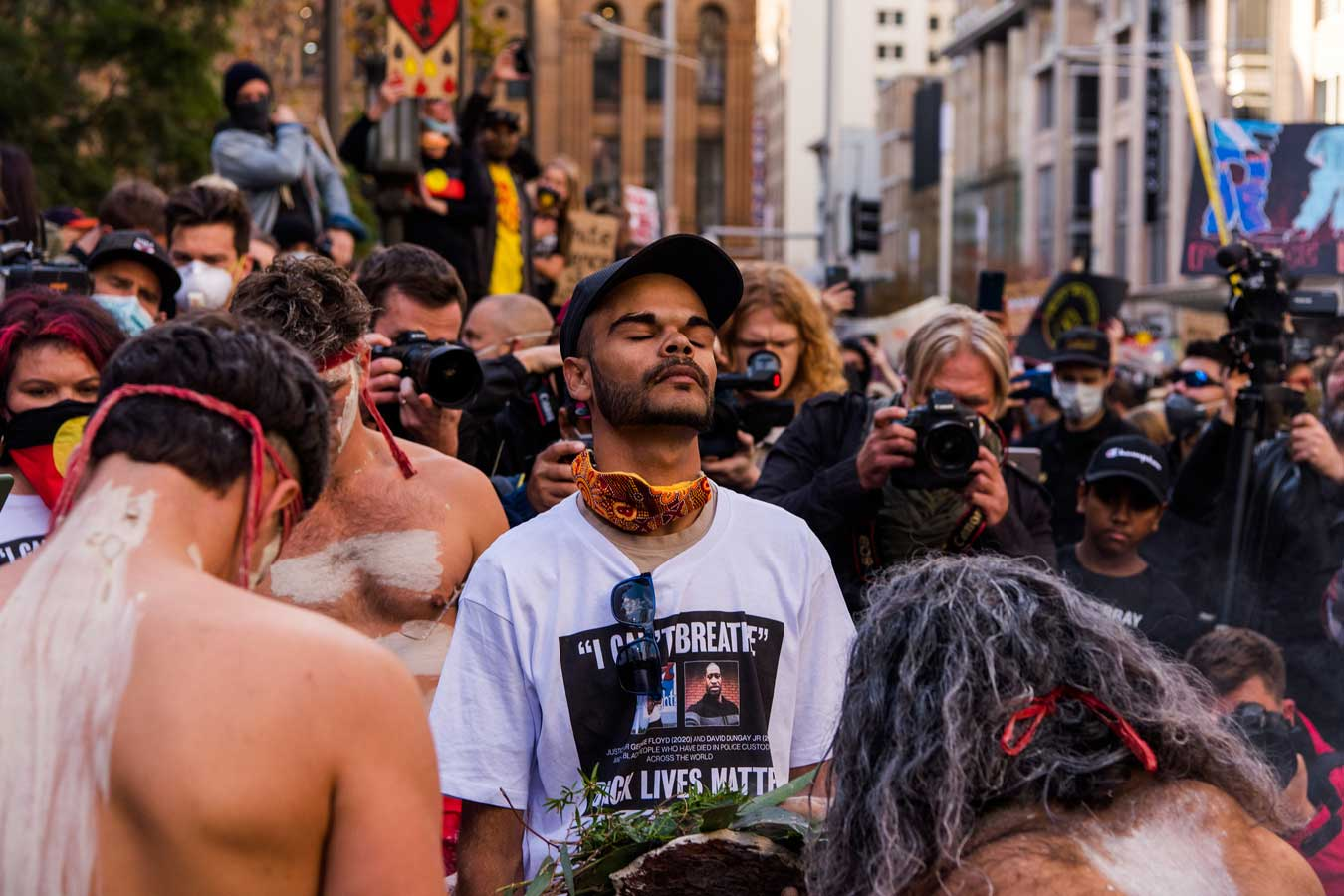 man-with-eyes-closed-back-turned-to-press-photographers-at-black-lives-matter-protest-sydney