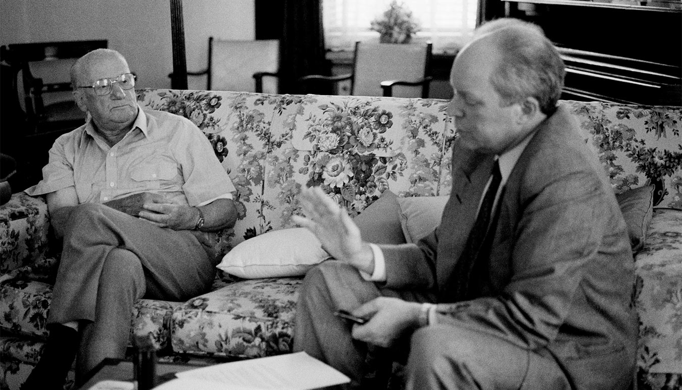 Author Roland Perry interviews Australian cricketer Sir Donald Bradman in 1995. Image by Dean Golja.